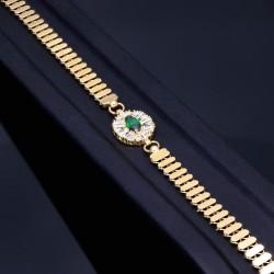 Trendiges Designer Armband aus 14K 585er Gelbgold mit einem wunderschönen Element besetzt mit einem funkelnden, tannengrünen Zirkonia